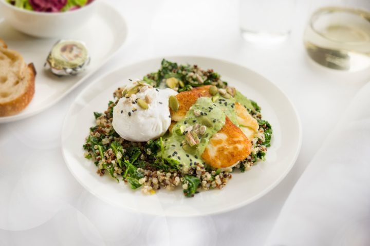 Poached-eggs-with-kale-quinoa-grilled-haloumi-pistachios-seeds-and-herbed-tahini-dressing-Business-breakfast-menu-ex-PERL-720x480