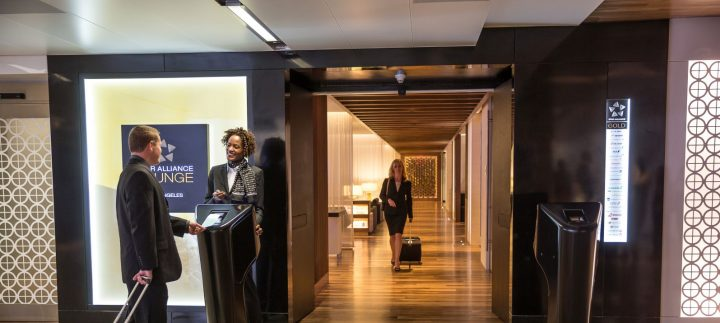 A premium class passenger is greeted on arrival at the lounge